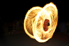 Fire spinning - fire dancing performance Royalty Free Stock Image