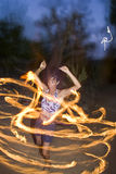 Fire spinning, hoop dancer, performing. Royalty Free Stock Photos