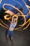Fire spinning, hoop dancer, performing. Stock Photography