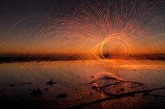 Fire Spinning Reflections stock photo