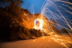 Fire spinning from steel wool Stock Photography