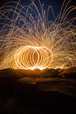 Fire spinning from steel wool Royalty Free Stock Photos