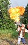 Fire spitting juggler Stock Photos