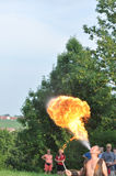 Fire spitting juggler Stock Images
