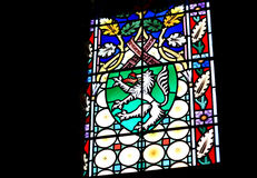 A fire-spouting lion. Stained-glass window depicting a coat of arms with a fire-spouting lion Stock Images