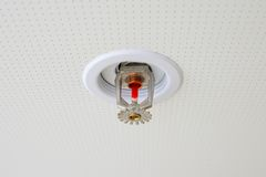 Fire sprinkler. Automatic fire sprinkler installed on ceiling for fire fighting Royalty Free Stock Images