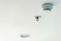 Fire sprinkler. On the ceiling stock photography