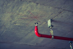 Fire sprinkler and red pipe ( Filtered image processed vintage stock images