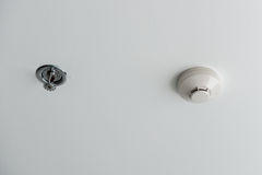 Fire Sprinkler and Smoke detector Stock Photos