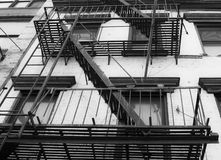 Fire stair outside a building. Crossing windows stock image