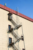 Fire staircase on the building. Metal fire ladder on the wall of the new building Royalty Free Stock Images