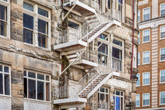 Fire stairs in old building. Metal fire stairs in a historical building under renovation Royalty Free Stock Photo