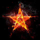 Fire star. On black background Royalty Free Stock Photography