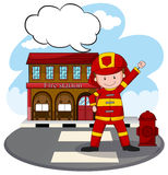 Fire station. Fire fighter standing in front of fire station Royalty Free Stock Photo