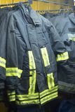 Fire fighters uniform station equipment. Fire station firefighter training equipment protective uniform used by fireman to fight fires and protect from flames Stock Image