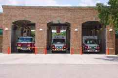 Fire station firehouse with paramedics & fire trucks Royalty Free Stock Photography