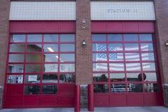 Fire Station Garage Door and American Flag Jerome Arizona USA stock image