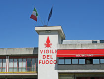 Fire station with Italian flags waving Stock Photos