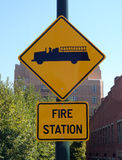 Fire Station Sign. Fire truck symbol on yellow fire station street sign stock photo