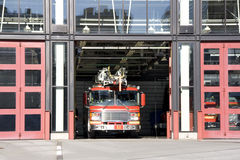 Fire station truck. A fire truck was leaving the station for emergency service Stock Photography