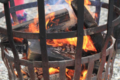 Fire in the steel basket Stock Photography