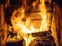 Fire in stone hearth. In rural house close up stock photo