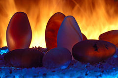 Fire and stones Stock Photos