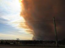 Ash cloud rolling towards city Stock Image