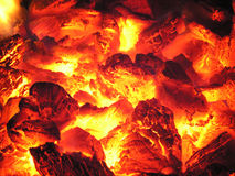 Fire in stove. Beautiful glow background from a real fire Royalty Free Stock Images
