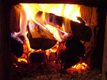 Fire in stove. In village Royalty Free Stock Photos