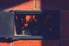 Fire in the stove with the door open. stock images