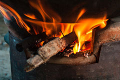 Fire on the stove. Firewood for the wood stove Royalty Free Stock Photo