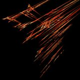 Fire Streak Meteor Shower Abstract. Fire meteor shower line traces special effect abstract, dark background, horizontal Stock Photo