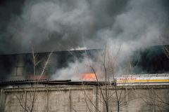 Fire and strong smoke in burning industrial building Stock Photography
