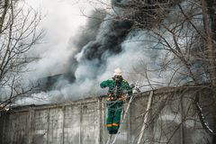 Fire and strong smoke in burning industrial building, danger accident disaster. With damage from fire concept Stock Image