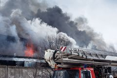 Fire and strong smoke in burning industrial building Royalty Free Stock Image