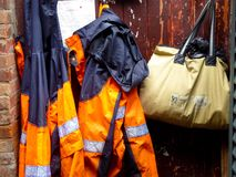 Fire suits hung on the wall Royalty Free Stock Photos