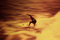 Fire Surfing 01. Surfing action blur with creative filters for the effect of surfing in fire water stock photography