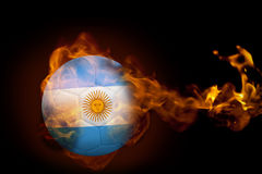 Fire surrounding argentina ball. Composite image of fire surrounding argentina ball against black Royalty Free Stock Image