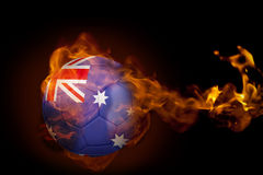 Fire surrounding australia ball. Composite image of fire surrounding australia ball against black Stock Photos