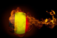 Fire surrounding belgium ball. Composite image of fire surrounding belgium ball against black Royalty Free Stock Images