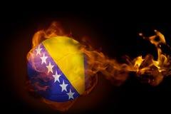 Fire surrounding bosnia ball. Composite image of fire surrounding bosnia ball against black Stock Images