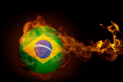 Fire surrounding brasil ball. Composite image of fire surrounding brasil ball against black Stock Photography