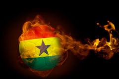 Fire surrounding cameroon ball. Composite image of fire surrounding cameroon ball against black Royalty Free Stock Image