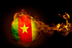 Fire surrounding cameroon ball Royalty Free Stock Photos