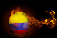 Fire surrounding colombia ball. Composite image of fire surrounding colombia ball against black Royalty Free Stock Photo