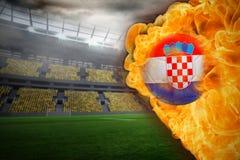 Fire surrounding croatia flag football. Composite image of fire surrounding croatia flag football against large football stadium with lights Royalty Free Stock Photo