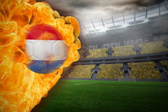 Fire surrounding dutch flag football. Composite image of fire surrounding dutch flag football against large football stadium with lights Royalty Free Stock Photos