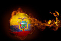 Fire surrounding ecuador ball. Composite image of fire surrounding ecuador ball against black Stock Photography
