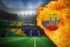 Fire surrounding ecuador flag football. Composite image of fire surrounding ecuador flag football against large football stadium with brasilian fans Stock Photos